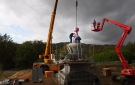 Placing the highest element – the last piece of the stupa