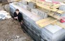 Aplicación del asfalto y terraplenado de las inmediaciones
