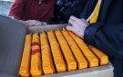 Inserting the Kangyur, the 102 volumes of the Buddha's words