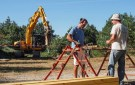 Installing a rebar-shaping station.